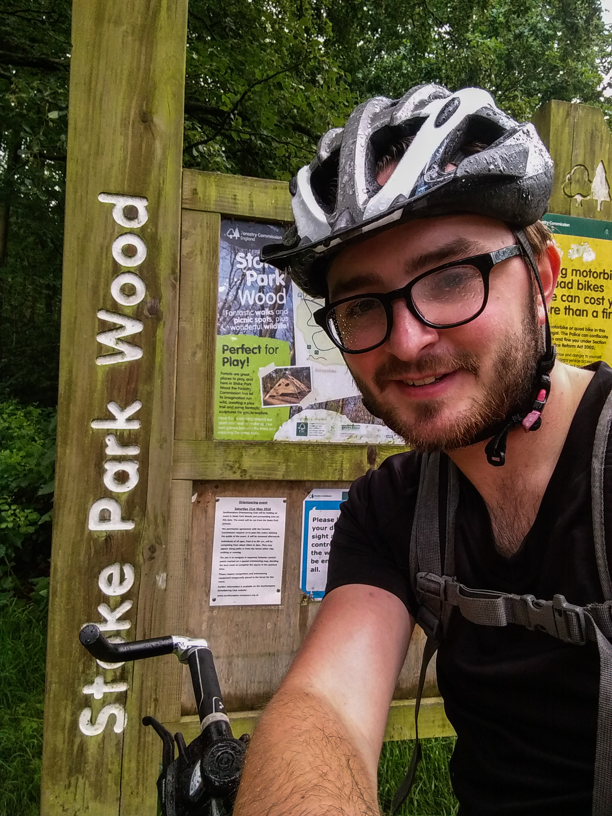 Standing by the Stoke Park Wood sign.